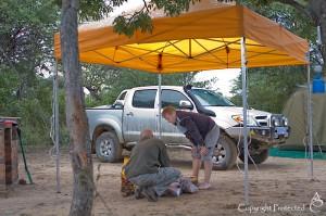 Building a camp-fire under the gazebo